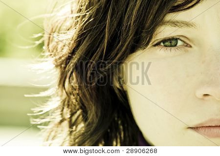 Woman portrait with impressive green eye.