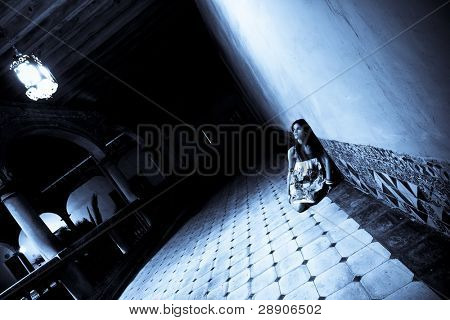 Terrified alone woman on dark corridor