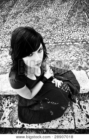 Angry young woman, dark goth background.