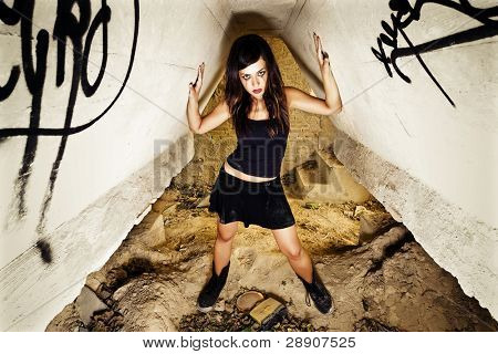 Rebel young girl posing in her hiding place