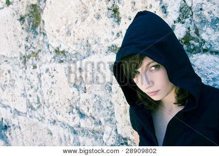 Young beautiful urban woman staring at camera