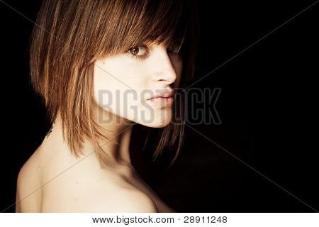 Young blond woman portrait staring at camera.