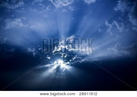 Sun under dark cloudscape, celestial background
