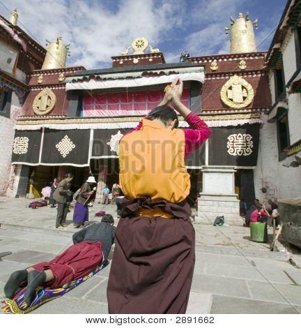 Tibetan Nun At Jokhang In Lhasa