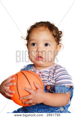 Young Girl Holding A Ball