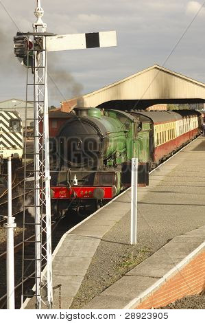 Steam Train At Station Platform