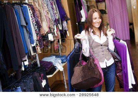 Young beautiful woman in a fashion shop