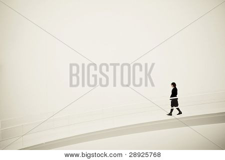Young woman going downhill on an empty space