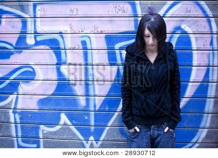Young beautiful girl posing on urban background.