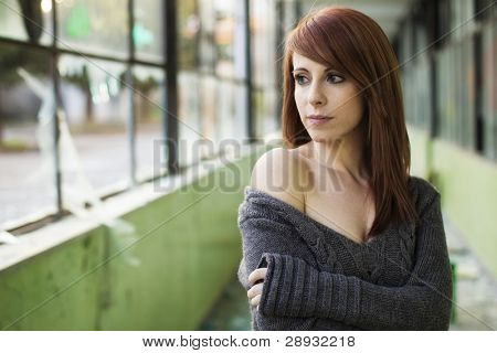 Young beautiful woman portrait in abandoned place