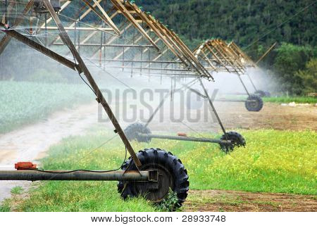 Closeup of a modern irrigation pivot system working on a farm