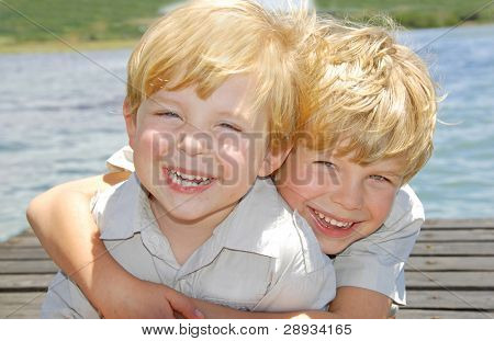 Happy young brothers hugging