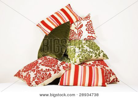 Combination of different cushions in red and green
