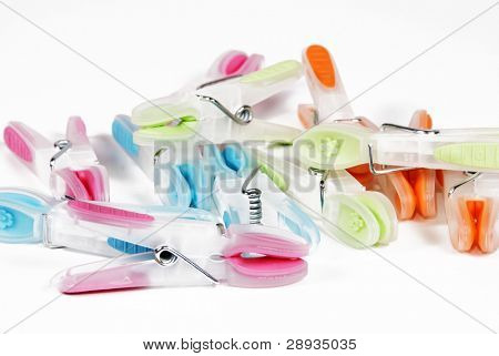 Collection of multi-coloured washing pegs