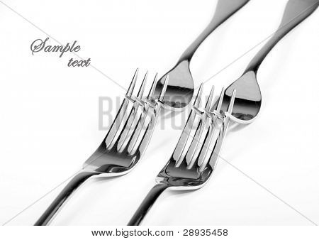 Table forks on white background