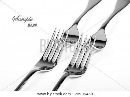 Table forks on white background