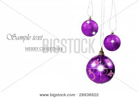 Three purple christmas baubles against white background with space for text