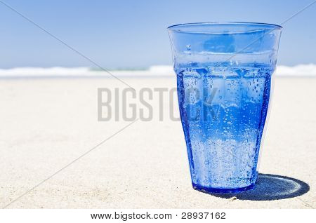 Refreshing healthy glass of sparkling water on the beach
