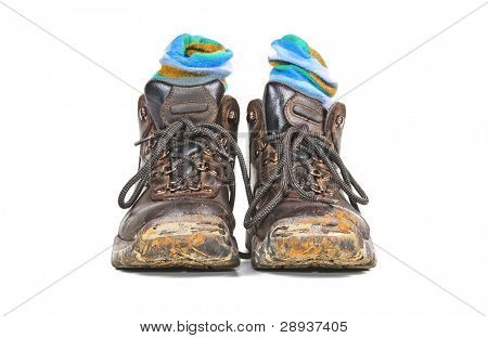a Pair of hiking boots with blue socks on a white background with space for text