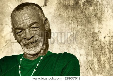 Old African man against a rustic background