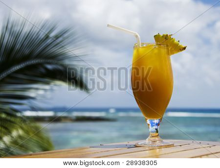 a Fresh healthy fruit cocktail drink on a tropical island