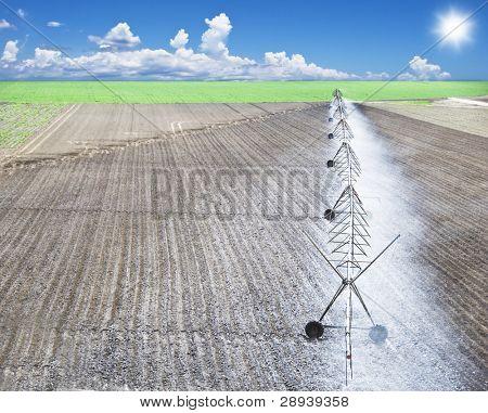 a Modern irrigation pivot system watering a farm field