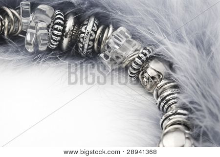 Jewelry made of stones and beads on feather - close up with space for text