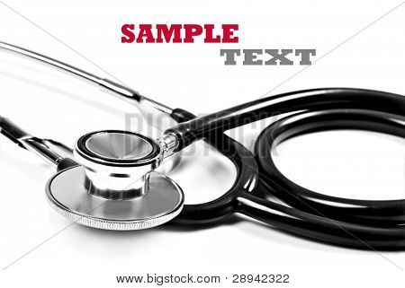 Close up of a doctor's stethoscope in black on a white background with space for text