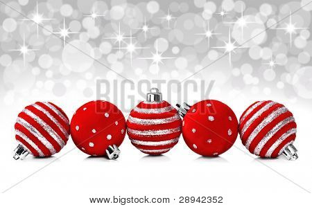 Red christmas decoration balls on a star background with space for text