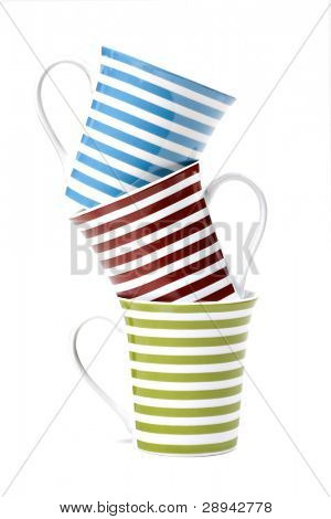 Three coffee mugs with red, green and blue stripes stacked up