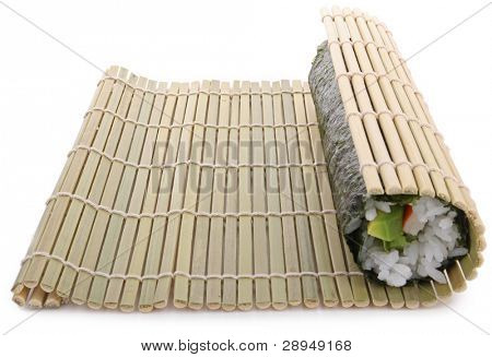 sushi preparation, bamboo mat and sushi maki roll