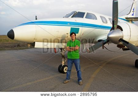Young Man Beside Airplane