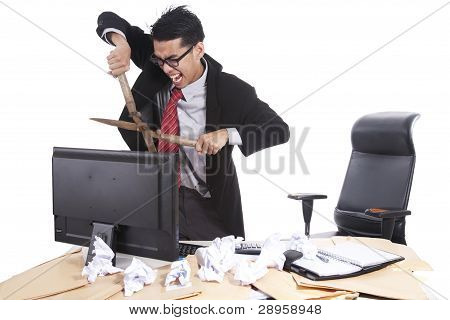Mad Businessman Cutting Computer