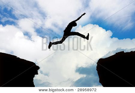 Silhouette Of Man Jumping Cliff
