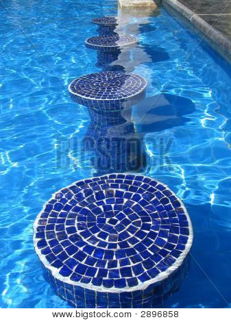 Blue Mosaic Pool Seats In Glistning Calm Pool