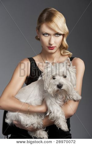 Old Fashion Blond Girl,she Has A Dog In Her Arms