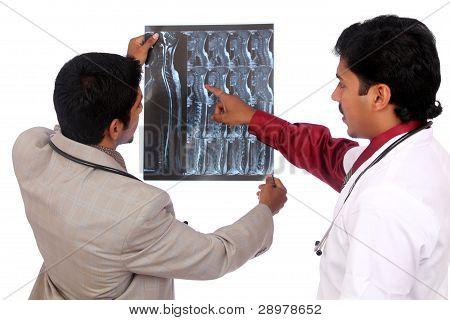Doctors examining the X-ray