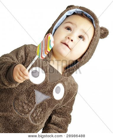 portrait of a handsome kid wearing a brown bear sweatshirt holding candy