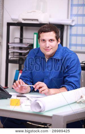 Mechanic sitting in office