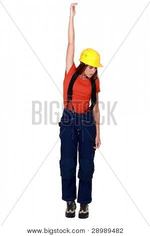 Tradeswoman being pulled up by an invisible object