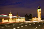stock photo of big-ben  - Nocturne scene with Big Ben behind light beams - JPG