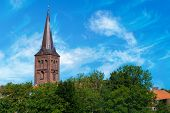 Steeple Of The Church Of Ploen In Germany Towering Over Trees. Nice View On The Church Tower On A Su poster