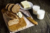 Whole Grain Bread With Sesame On A Wooden Board. Sliced Bread. Hdopatchemazhnaya Napkin. A Piece Of  poster