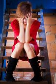 stock photo of upskirt  - Beautiful blond woman covering her face with her hands - JPG