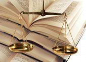 stock photo of judiciary  - Scales Of Justice Atop Legal Books  - JPG