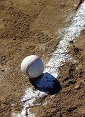 Fair Ball Or Foul Ball - It depends upon your perspective. A baseball near a chalk line.