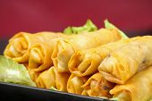 picture of nem  - egg rolls with laitus on a black plate - JPG