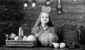Kid Girl Near Basket Full Of Fresh Vegetables Harvest Rustic Style. Child Girl Presenting Harvest Of poster