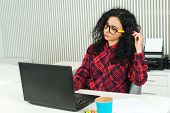 Young Pretty Woman Working In Modern Office. Smart Girl Working With New Startup. Worker Woman In Gl poster