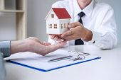 Real Estate Broker Agent Presenting And Consult To Customer To Decision Making Sign Insurance Form A poster